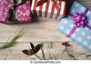 christmas gifts on a wooden surface