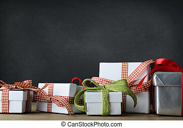 Christmas Gifts on Desk with Blackboard Background