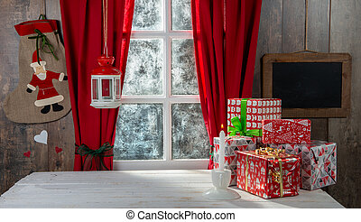 Christmas gifts on the table, near rustic window