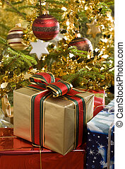 christmas gifts under christmas tree close up