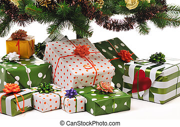 Christmas gifts under decorated fir tree