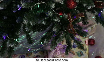 Christmas gifts under the Christmas tree. - New Year gifts,...