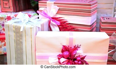 Christmas gifts under tree. Shift motion with change focus...