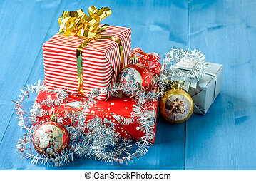 Christmas gifts with some ornaments on a blue background
