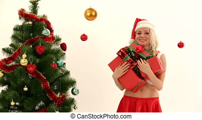 Christmas gifts - Woman dressed as Santa holding lots of...