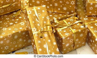 Christmas gifts wrapped in gold paper