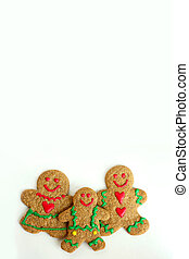 A Christmas Gingerbread cookie family of man, woman, and child is isolated on a white background, with copy-space for text or to use as a greeting card.