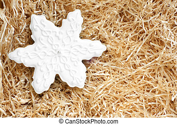 Christmas gingerbread cookie made in the shape of a snowflake