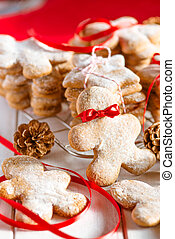 Christmas gingerbread cookie man with red ribbon tie
