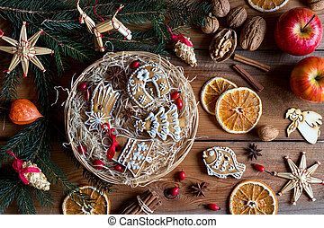 Christmas gingerbread cookies in a round wicker basket on a wooden table