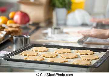 Christmas gingerbread cookies in a row on tray