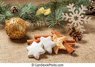 Christmas gingerbread cookies on sackcloth with cinnamon and star anise