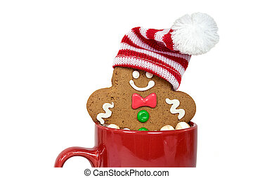 Christmas gingerbread man in hot chocolate