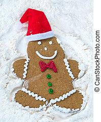 Christmas gingerbread man snow angel