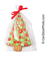 Christmas gingerbread tree cookie in transparent packing