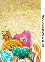 christmas gingerbreads on paper background with golden stars