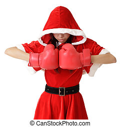 Christmas girl with boxing gloves posing over white...