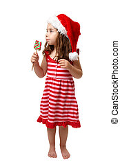 Christmas girl with candy - Christmas girl eating a lollipop...