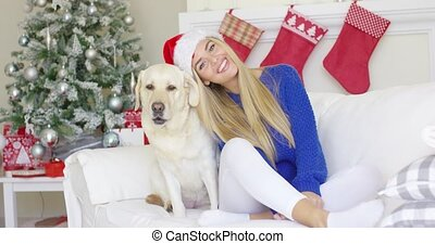 Christmas girl with her dog friend at the couch
