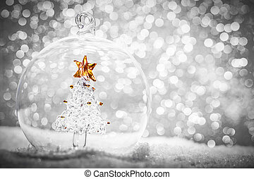 Christmas glass ball with crystal tree inside in snow
