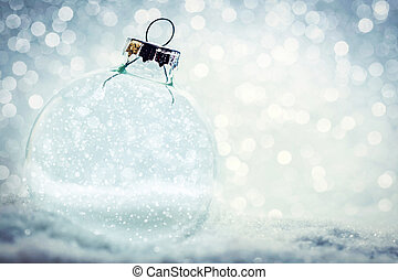Christmas glass ball with empty interior. Snow and glitter...