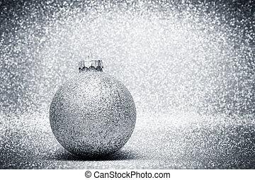 Christmas glass balls decoration on silver glitter...