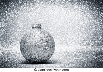 Christmas glass balls decoration on silver glitter...