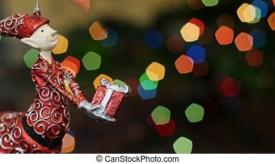Christmas gnome toy shakes at bokeh. Title area - Christmas...