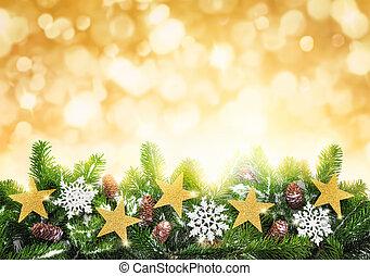 Christmas gold background - Studio shot of fir twigs...