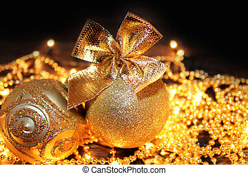 Christmas Golden balls on a black background.