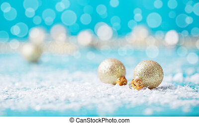 Christmas golden balls with snow decoration on blue background. Copy space.