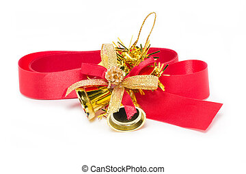 Christmas golden bell with red ribbon isolated on white background
