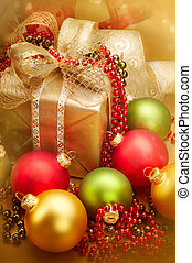 Christmas golden gift box with a ribbon and baubles