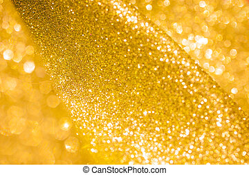 Christmas Golden Glittering background.Holiday Gold abstract texture