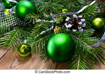 Christmas green ornament wreath on the wooden background,...