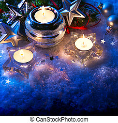 christmas greeting card with christmas candle decoration and christmas decoration on blue background