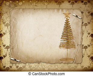 Christmas greeting card with gold metal firtree on the paper floral background