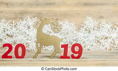 Christmas greeting card with ornaments on wooden background