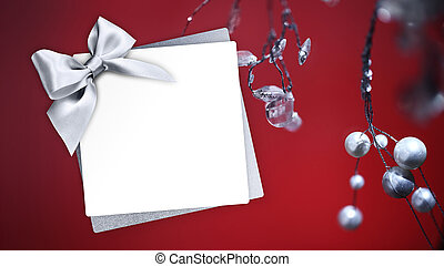 christmas greeting gift card with silver ribbon bow and mistletoe on red background template white copy space
