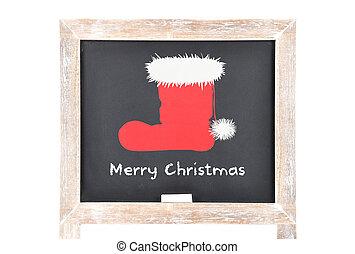 Christmas greetings with Santas hat on blackboard