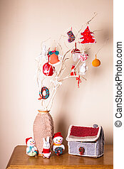 Christmas handmade decor on the branches over wall