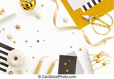 Christmas handmade gifts packing frame on white background with copy space, flat lay, top view. Mockup with twine rope, gold and black colors boxes and ribbon