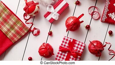 Christmas hat and baubles around gifts - From above shot of...