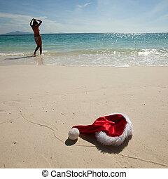Christmas hat on beach