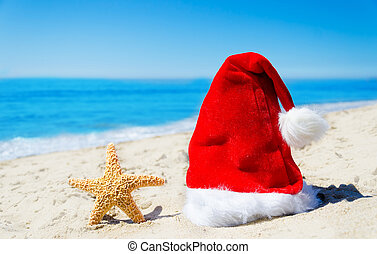 Christmas hat with starfish on the beach
