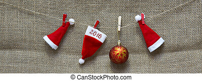 Christmas hats  and New Year  2016 background.