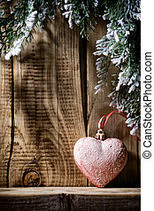 Christmas heart, Christmas decor on the wooden background.