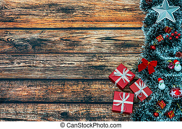 Christmas holiday background with gift boxes and decorations on wooden table.