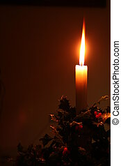 christmas holiday candle with holly decoration