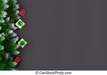 Christmas holiday composition. Festive Christmas decorations, baubles, fir tree branches, confetti star on dark black background with copy space. Banner mockup, postcard. Flat lay, top view, overhead